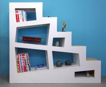 Een boekenkast en trap tegelijk